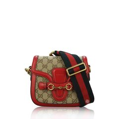 Gucci	Gucci GG Saddle Crossbody Bag in Red